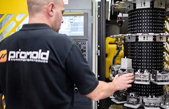 Priomold employee setting up a machine
